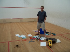 Joe putting together the shot for the cover for Ishmael and the Return of the Dugongs on a local squash court.