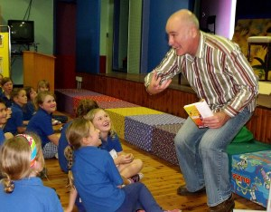 DC Green does a dramatic reading for the students of Macksville Primary School.
